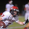 VIEW<br /> Fairview's Cole Walbrecht runs the ball against Legacy.<br /> Photo by Marty Caivano/Camera/Sept. 30, 2010