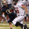 VIEW<br /> Fairview's Ben Meyer is shadowed by Mason Doubleday of Legacy.<br /> Photo by Marty Caivano/Camera/Sept. 30, 2010