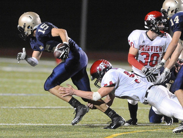 VIEW<br /> Fairview's Nikolai Jauhiainen takes down Mason Doubleday of Legacy, after Doubleday picked up a fumble dropped by Ben Meyer, #30.<br /> Photo by Marty Caivano/Camera/Sept. 30, 2010