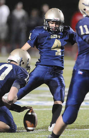 VIEW<br /> Legacy kicker Hugo Aguirre attempts a field goal against Fairview.<br /> Photo by Marty Caivano/Camera/Sept. 30, 2010