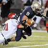 VIEW<br /> Fairview's Kevin Kang takes down Dezmon Fernandez of Legacy.<br /> Photo by Marty Caivano/Camera/Sept. 30, 2010