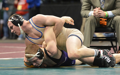 Roosevelt's Phil Downing wrestles Tyler Oberg, Discovery Canyon in the 145-pound 4A class match during the state wrestling championships at the Pepsi Center in Denver on Saturday. February 23, 2013 staff photo/ David R. Jennings