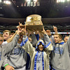 Broomfield's wrestling team raises the trophy for the state class 4A wrestling championships at the Pepsi Center in Denver on Saturday.<br /> February 23, 2013<br /> staff photo/ David R. Jennings