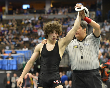 Roosevelt's Jace Lopez celebrates winning the 4A 138-pound match against Ryan Daves, Montezuma-Cortez during the state wrestling championships at the Pepsi Center in Denver on Saturday. February 23, 2013 staff photo/ David R. Jennings