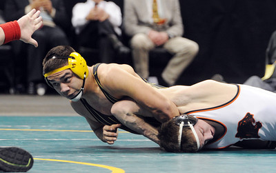 Francisco Marquez, left,  of Thompson Valley, beats Seager Oliver of Montezuma-Cortez at 160 pounds. For more photos of the wrestling, go to www.dailycamera.com. Cliff Grassmick / February 23, 2013