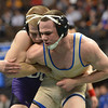 Roosevelt's Phil Downing wrestles Tyler Oberg, Discovery Canyon in the 145-pound 4A class match during the state wrestling championships at the Pepsi Center in Denver on Saturday.<br /> February 23, 2013<br /> staff photo/ David R. Jennings