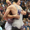 Wiggin's Garret Walker, right, is hugged by Mitch VanDuran, Segwick County- Fleming after Walker won the 182-pound 2A class match during the state wrestling championships at the Pepsi Center in Denver on Saturday.<br /> February 23, 2013<br /> staff photo/ David R. Jennings
