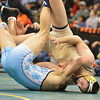Broomfield's Zach wrestles Chaz Poison, Valor Christian in the 170-pound 4A class match during the state wrestling championships at the Pepsi Center in Denver on Saturday.<br /> February 23, 2013<br /> staff photo/ David R. Jennings