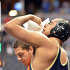 Legacy's  Skylar McWee stops a nosebleed  while wrestling Dexter Bess, Smokey Hill,  in the 220-pound consolation round match in class 5A during the state wrestling championships at the Pepsi Center in Denver on Saturday.<br /> February 23, 2013<br /> staff photo/ David R. Jennings