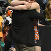 Mead's Kyle Couch hugs his coach, Ty Tatham after defeating Trenton Gustafson, Montezuma-Cortez w in the 182-pound 4A class match during the state wrestling championships at the Pepsi Center in Denver on Saturday.<br /> February 23, 2013<br /> staff photo/ David R. Jennings