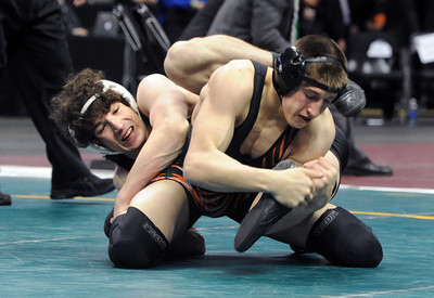 Jace Lopez, left,  of Roosevelt High School works against Ryan Daves of Montezuma Cortez. For more photos of the wrestling, go to www.dailycamera.com. Cliff Grassmick / February 23, 2013