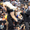 "Zach Stodden of Broomfield jumps in the arms of his coaches after winning state at 170 pounds.<br /> For more photos of the wrestling, go to  <a href=""http://www.dailycamera.com"">http://www.dailycamera.com</a>.<br /> Cliff Grassmick / February 23, 2013"