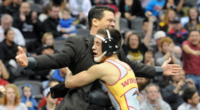 Joel Salomon of Windsor hugs his coach after winning the 113 pound 4A championship match. For more photos of the wrestling, go to www.dailycamera.com. Cliff Grassmick / February 23, 2013