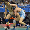 Broomfield's Zach Stodden, left, wrestles Chaz Poison, Valor Christian in the 170-pound 4A class match during the state wrestling championships at the Pepsi Center in Denver on Saturday.<br /> February 23, 2013<br /> staff photo/ David R. Jennings