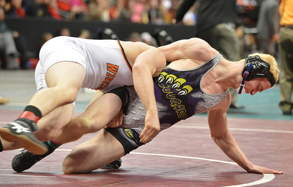 Wiggin's Garret Walker, left,  wrestles Mitch VanDuran, Segwick County- Fleming in the 182-pound 2A class match during the state wrestling championships at the Pepsi Center in Denver on Saturday.<br /> February 23, 2013<br /> staff photo/ David R. Jennings