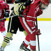 Monarch's Joey Buchan (left) slams Regis' Jack O'Neil (right) during their hockey game in Superion, Colorado February 11, 2013. BOULDER DAILY CAMERA/ Mark Leffingwell