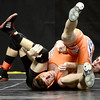 Austin Krier (front), Sterling, works to not get pinned by Joshua Miller (back), BEN, during their 132 3A Colorado Wrestling State Championship preliminary match in Denver, Colorado February 21, 2013. BOULDER DAILY CAMERA/ Mark Leffingwell