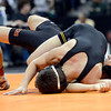 "Erie High School's Anthony Nieto tries to avoid being pinned by Thompson Valley's Vladyslav Kazakov during the Class 4A 106-pound match during the Colorado State Wrestling Championship prelims on Thursday, Feb. 21, at the Pepsi Center in Denver. For more photos of the tournament go to  <a href=""http://www.dailycamera.com"">http://www.dailycamera.com</a><br /> Jeremy Papasso/ Camera"