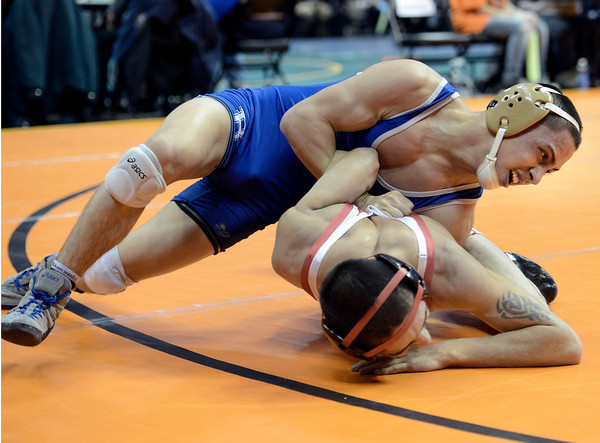 "Broomfield High School's Drew Romero tries to flip Montrose High School's Emmanuel Sandoval during the Class 4A 113-pound match during the Colorado State Wrestling Championship prelims on Thursday, Feb. 21, at the Pepsi Center in Denver. Romero won the match. For more photos of the tournament go to  <a href=""http://www.dailycamera.com"">http://www.dailycamera.com</a><br /> Jeremy Papasso/ Camera"