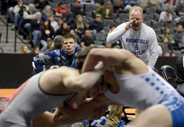 "Broomfield High School coaches Alex Joseph, left, and Charlie Hacker yell to Broomfield's Jared Albo as he wrestles Durango's Nick Tarpley during the Class 4A 152-pound match during the Colorado State Wrestling Championship prelims on Thursday, Feb. 21, at the Pepsi Center in Denver. For more photos of the tournament go to  <a href=""http://www.dailycamera.com"">http://www.dailycamera.com</a><br /> Jeremy Papasso/ Camera"