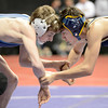 """Legacy High School's Donovan Cogil, right, ties up with Greeley West High School's Dylan West during the Class 5A 113-pound match during the Colorado State Wrestling Championship prelims on Thursday, Feb. 21, at the Pepsi Center in Denver. For more photos of the tournament go to  <a href=""""http://www.dailycamera.com"""">http://www.dailycamera.com</a><br /> Jeremy Papasso/ Camera"""
