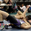 """Mountain View High School's Matt Combs tries to avoid being pinned by Palmer Ridge High School's Tyler Thalhammer during the Class 4A 138-pound match during the Colorado State Wrestling Championship prelims on Thursday, Feb. 21, at the Pepsi Center in Denver. For more photos of the tournament go to  <a href=""""http://www.dailycamera.com"""">http://www.dailycamera.com</a><br /> Jeremy Papasso/ Camera"""