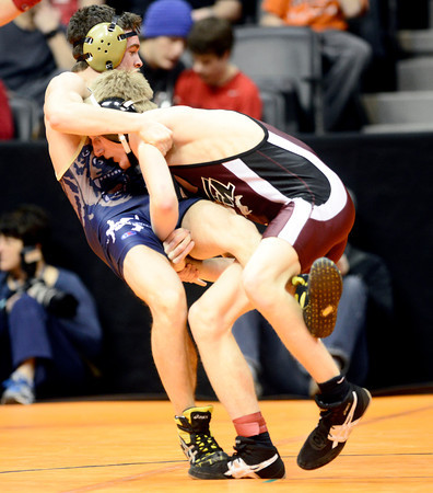 Jacob Gerken (right), Fort Morgan, gets a takedown on Tyler Thalhammer (left), Palmer Ridge, during their 138lb 4A Colorado Wrestling State Championship match in Denver, Colorado February 21, 2013. BOULDER DAILY CAMERA/ Mark Leffingwell
