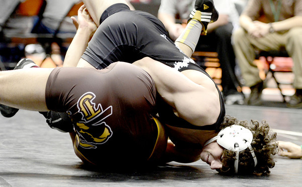 Jace Lopez (right), Roosevelt, nearly pins Noel Estrada (left), Thomas Jefferson, during their 138lb 4A Colorado Wrestling State Championship match in Denver, Colorado February 21, 2013. BOULDER DAILY CAMERA/ Mark Leffingwell