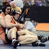 "Wiggins High School's Danny McCombs, at right, tries to escape the grasp of Del Norte's Brennan Pacheco during the Class 2A 145-pound match during the Colorado State Wrestling Championship prelims on Thursday, Feb. 21, at the Pepsi Center in Denver. McCombs lost the match. For more photos of the tournament go to  <a href=""http://www.dailycamera.com"">http://www.dailycamera.com</a><br /> Jeremy Papasso/ Camera"
