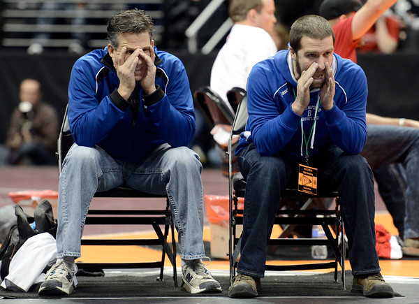 "Broomfield High School wrestling coaches Allen McGirl, left, and Joe Pereira watch in suspense as Phil Downing wrestles Pueblo Centennial's Nick Rocha during the Class 4A match during the Colorado State Wrestling Championship prelims on Thursday, Feb. 21, at the Pepsi Center in Denver. Downing won the match. For more photos of the tournament go to  <a href=""http://www.dailycamera.com"">http://www.dailycamera.com</a><br /> Jeremy Papasso/ Camera"