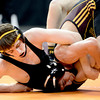 Ben Hewson (left), Thompson Valley, wrestles Matteo Ambriz (right) during their 126 4A Colorado Wrestling State Championship preliminary match in Denver, Colorado February 21, 2013. BOULDER DAILY CAMERA/ Mark Leffingwell