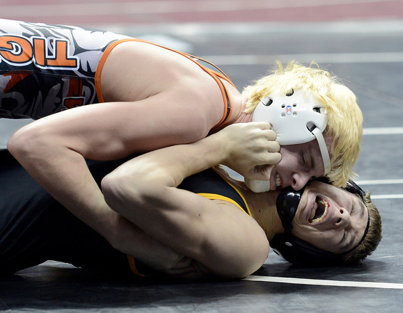 """Wiggins High School's Tryston Keefe works to pin Meeker's Anthony Watt during the Class 2A match during the Colorado State Wrestling Championship prelims on Thursday, Feb. 21, at the Pepsi Center in Denver. For more photos of the tournament go to  <a href=""""http://www.dailycamera.com"""">http://www.dailycamera.com</a><br /> Jeremy Papasso/ Camera"""