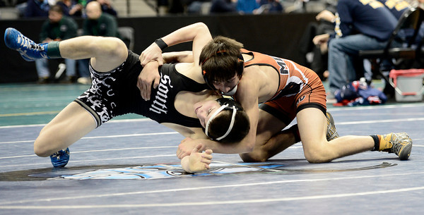 Sage Budd (right), Mead, wrestles Davis Baxter (left), Pueblo South, during their 113lb 4A Colorado Wrestling State Championship preliminary match in Denver, Colorado February 21, 2013. BOULDER DAILY CAMERA/ Mark Leffingwell