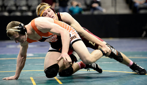 Tyler Stratman (right), Brush, wrestles Taylor Maik (left), LJ, during their 160lb 3A Colorado Wrestling State Championship preliminary match in Denver, Colorado February 21, 2013. BOULDER DAILY CAMERA/ Mark Leffingwell