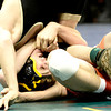 Joel Contreras (left), Sterling, tries to pin Dalton Gregory (right), PS, during their 138lb 3A Colorado Wrestling State Championship preliminary match in Denver, Colorado February 21, 2013. BOULDER DAILY CAMERA/ Mark Leffingwell