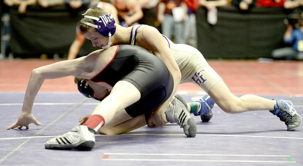 Joseph Preito (top), Holy Family, takes down Zack O'Dell (bottom), Gunnison, during their 126lb 3A Colorado Wrestling State Championship preliminary match in Denver, Colorado February 21, 2013. BOULDER DAILY CAMERA/ Mark Leffingwell