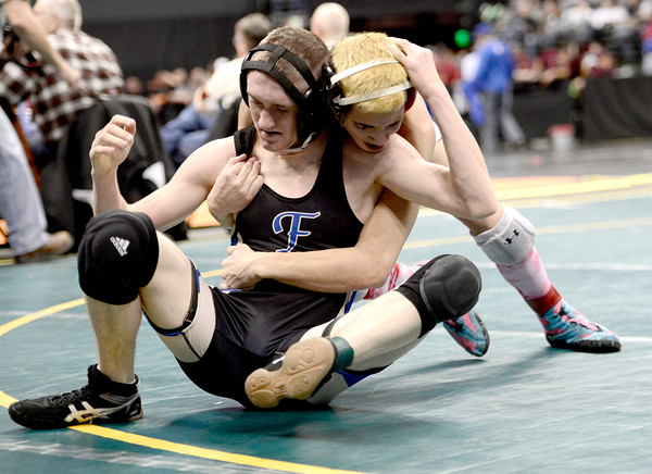 Jake Yslas (left), Florence, gets pressure from Aaron Cisneros (right), Jefferson, during their 126lb 3A Colorado Wrestling State Championship preliminary match in Denver, Colorado February 21, 2013. BOULDER DAILY CAMERA/ Mark Leffingwell