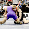 William Schell (right), Erie, wrestles Dominique Hughes (left), Mesa Ridge, during their 145lb 4A Colorado Wrestling State Championship match in Denver, Colorado February 21, 2013. BOULDER DAILY CAMERA/ Mark Leffingwell
