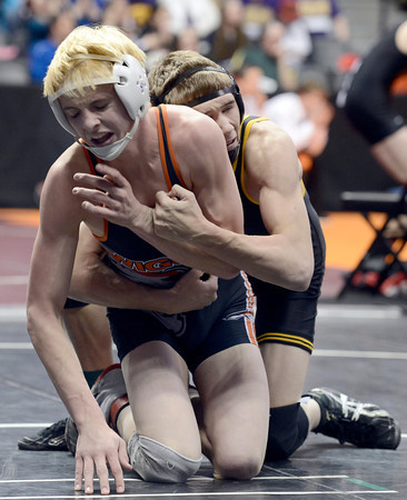 """Wiggins High School's Tryston Keefe, at front, tries for escape points while wrestling Meeker's Anthony Watt during the Class 2A 138-pound match during the Colorado State Wrestling Championship prelims on Thursday, Feb. 21, at the Pepsi Center in Denver. Keefe won the match with a pin in the third period. For more photos of the tournament go to  <a href=""""http://www.dailycamera.com"""">http://www.dailycamera.com</a><br /> Jeremy Papasso/ Camera"""