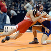 "Broomfield High School's Drew Romero gets cross-faced by Montrose High School's Emmanuel Sandoval during the Class 4A 113-pound match during the Colorado State Wrestling Championship prelims on Thursday, Feb. 21, at the Pepsi Center in Denver. Romero won the match. For more photos of the tournament go to  <a href=""http://www.dailycamera.com"">http://www.dailycamera.com</a><br /> Jeremy Papasso/ Camera"