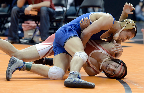"Broomfield High School's Drew Romero tries to get some back points Montrose High School's Emmanuel Sandoval during the Class 4A 113-pound match during the Colorado State Wrestling Championship prelims on Thursday, Feb. 21, at the Pepsi Center in Denver. For more photos of the tournament go to  <a href=""http://www.dailycamera.com"">http://www.dailycamera.com</a><br /> Jeremy Papasso/ Camera"