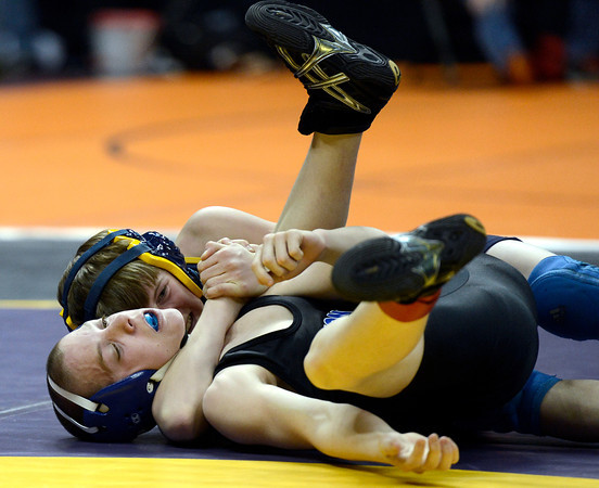 """Lyons HIgh School's William Hickman ties to avoid a pin by Nucla High School's Aaron Morgan during the Class 2A 106-pound match during the Colorado State Wrestling Championship prelims on Thursday, Feb. 21, at the Pepsi Center in Denver. For more photos of the tournament go to  <a href=""""http://www.dailycamera.com"""">http://www.dailycamera.com</a><br /> Jeremy Papasso/ Camera"""