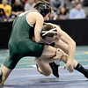 Joel Lambert (right), Niwot, gets a takedown on Tristen Wolf (left), Conifer, during their 132 4A Colorado Wrestling State Championship preliminary match in Denver, Colorado February 21, 2013. BOULDER DAILY CAMERA/ Mark Leffingwell