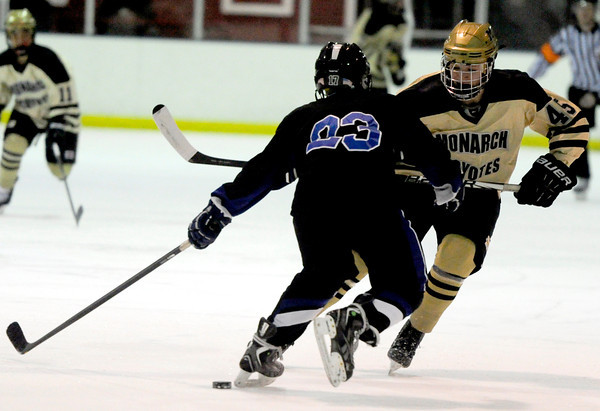 Monarch's Max Legere (right) takes the puck past Columbine's Chase Uptson (left) during their hockey game in Superior , Colorado February 4, 2013. BOULDER DAILY CAMERA/ Mark Leffingwell