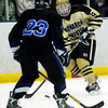 Monarch's Walker Harris (right) takes a shot between the legs of  Columbine's Chase Upson (left) during their hockey game in Superior , Colorado February 4, 2013. BOULDER DAILY CAMERA/ Mark Leffingwell