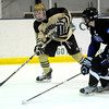 Monarch's Walker Harris (left) takes a shot past Columbine's Andy Wright (right) during their hockey game in Superior , Colorado February 4, 2013. BOULDER DAILY CAMERA/ Mark Leffingwell