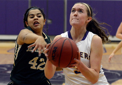 Boulder High School's Sarah Burns goes for a layup in front of Courtney Vigil  during a game against Bear Creek High School on Tuesday, Feb. 26, in Boulder. For more photos of the game go to www.dailycamera.com Jeremy Papasso/ Camera