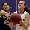 "Boulder High School's Sarah Burns goes for a layup in front of Courtney Vigil  during a game against Bear Creek High School on Tuesday, Feb. 26, in Boulder. For more photos of the game go to  <a href=""http://www.dailycamera.com"">http://www.dailycamera.com</a><br /> Jeremy Papasso/ Camera"
