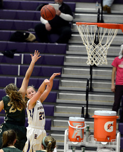 Boulder High School's Lena Jaycox takes a shot over Ariana Green during a game against Bear Creek High School on Tuesday, Feb. 26, in Boulder. For more photos of the game go to www.dailycamera.com Jeremy Papasso/ Camera