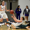 "Boulder High School's Lena Jaycox passes the ball after fighting for a loose ball with Daneeca Medina during a game against Bear Creek High School on Tuesday, Feb. 26, in Boulder. For more photos of the game go to  <a href=""http://www.dailycamera.com"">http://www.dailycamera.com</a><br /> Jeremy Papasso/ Camera"